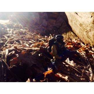 Image of: A Marine is scouting a...