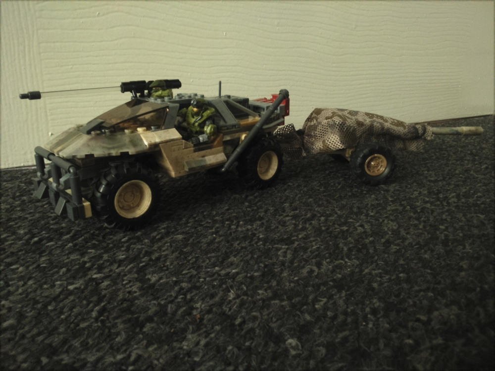 """Image of: Heavy Transport and Recon Warthog with """"Alice"""" Artillery trailer."""