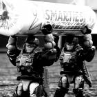 Image of: Marines carry large smarties back to base black and white 2555