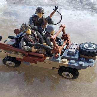 Image of: Captured schwimmwagen driver escorted by Allied soldiers