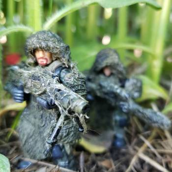 Sniper team moving to postion